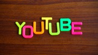 Youtube in colorful toy letters on wood background